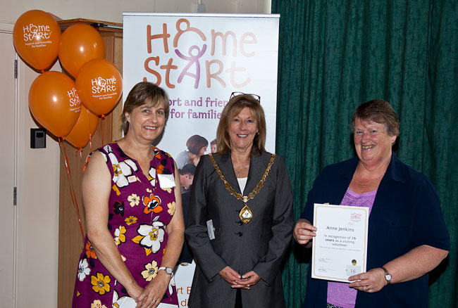 Anne Jenkins receiving a certificate for 16 years volunteering