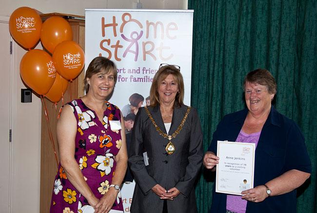 Anne Jenkins receiving a certificate for 16 years volunteering